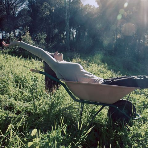 Woman blissed out in a wheelbarrow