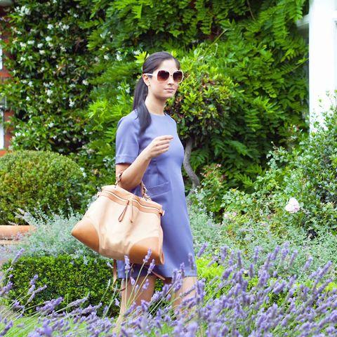Woman in sunglasses in garden