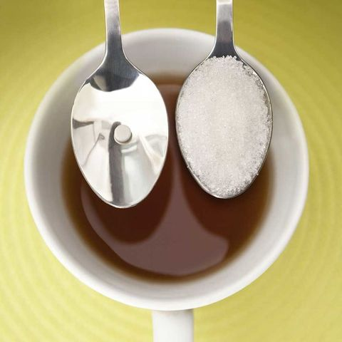 Sugar and sweetner on spoon