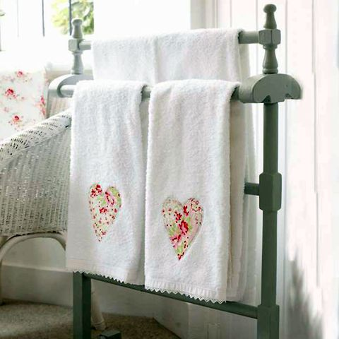 Towels with applique hearts sewn on