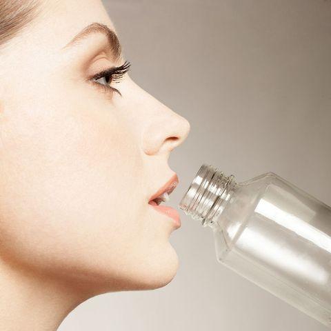 Woman drinking from bottle