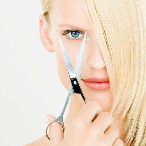 Woman hair dressing scissors