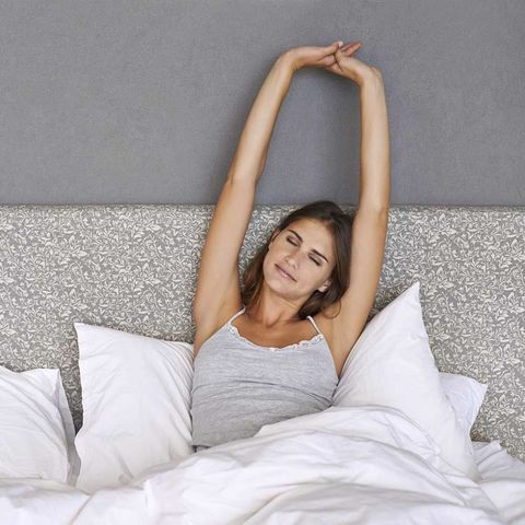 Woman waking up stretching