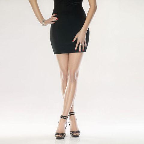 Woman standing in black dress