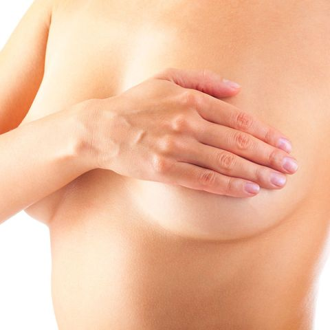 Woman checking for breast lumps