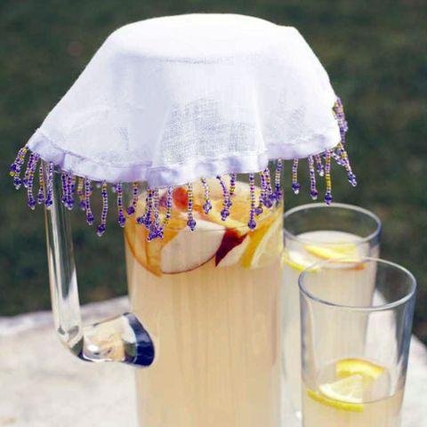 Beaded jug cover on a jug