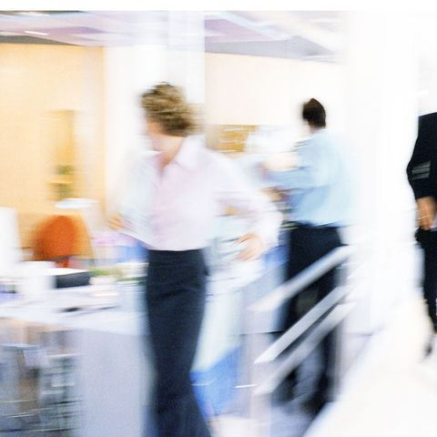 Blurred shot of people in office