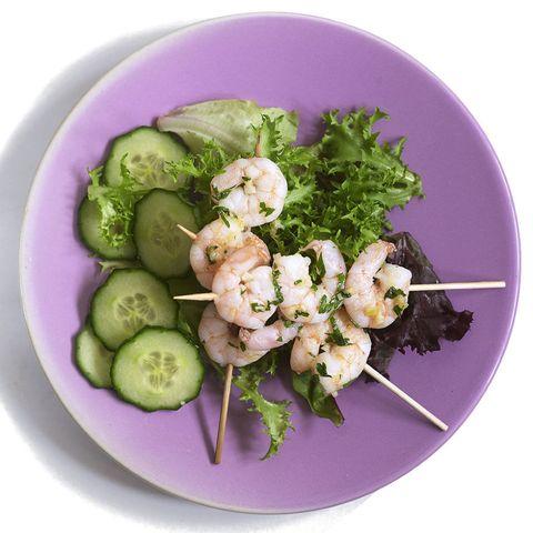 Prawn skewers with salad