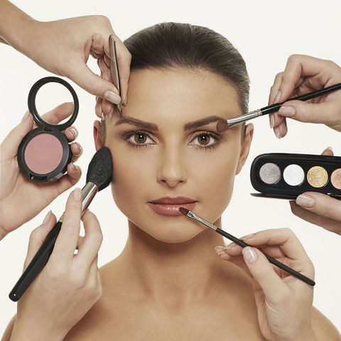 Woman having make-up applied