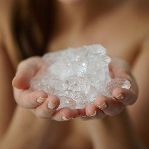 Woman holding ice cubes