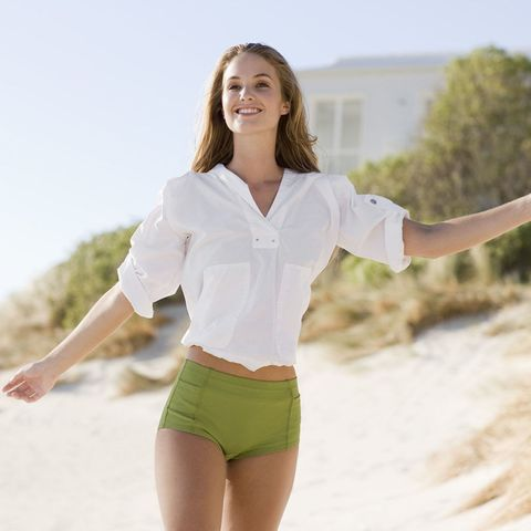 Woman smiling on the beach