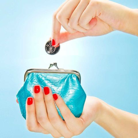 Hands dropping coin in purse