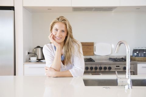 Blonde woman smiling in kitchen