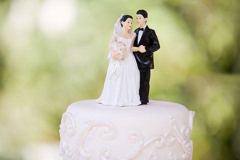 Married couple on wedding cake