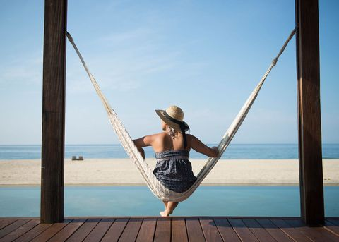 Woman on holiday in hammock