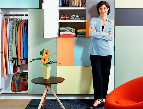Woman standing outside of organised closet
