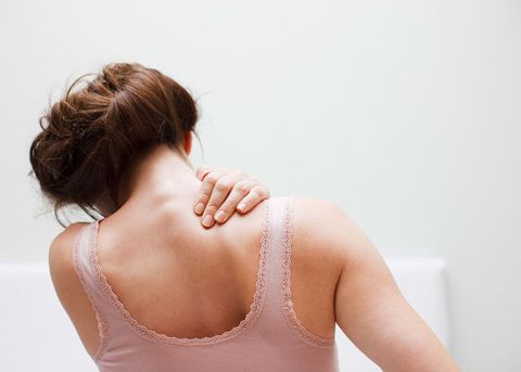 Woman rubbing back
