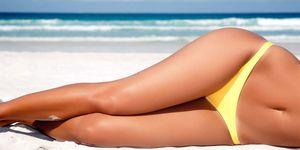 Tanned legs on a beach