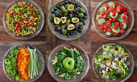 Bowls of salad on a wooden table