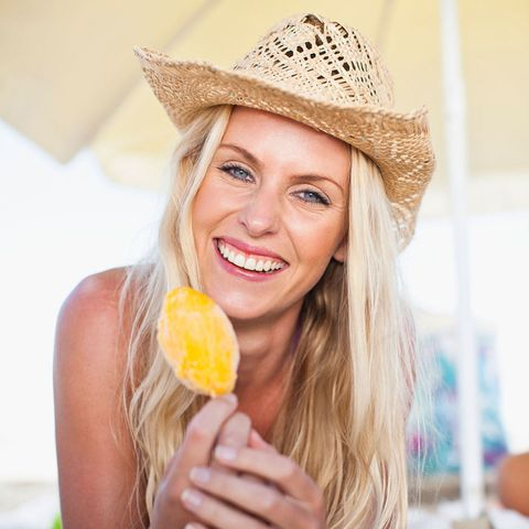 Woman smiling eating iced lolly