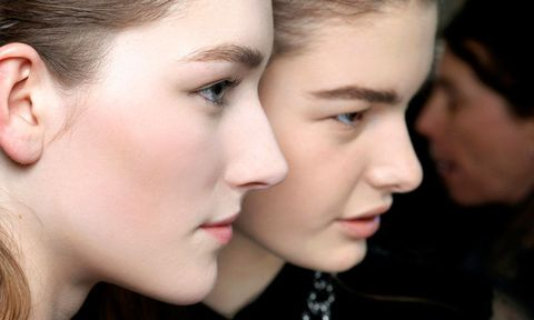 Two models with clear, highlighted skin