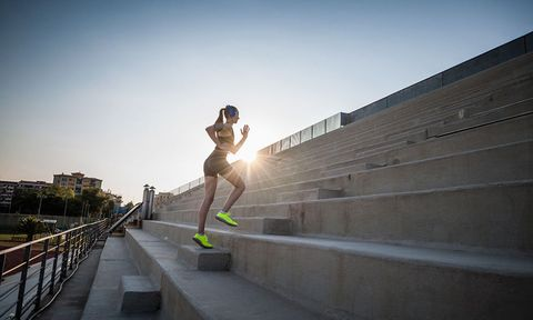 woman running up concrete stairs