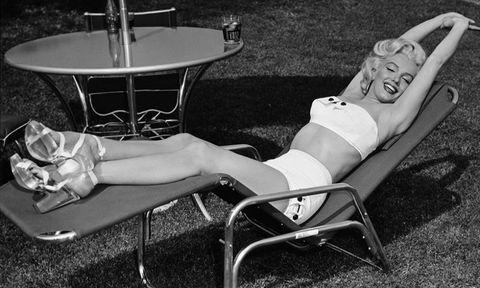 marilyn monroe lying on a sun lounger