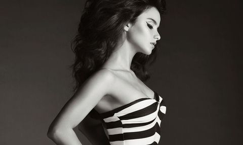 woman in black and white stripe swimsuit
