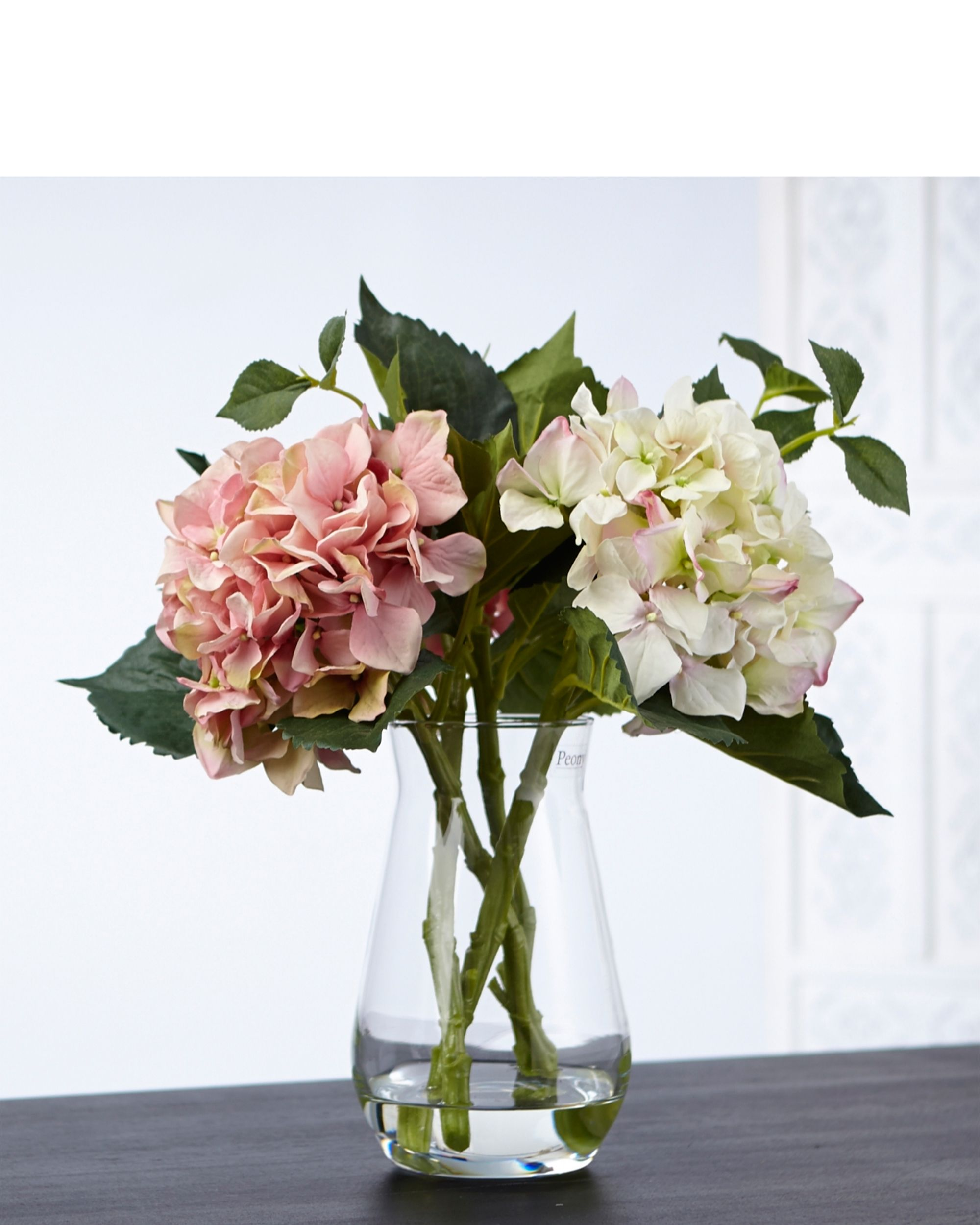 Artificial peonies in a vase