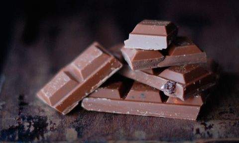 Chocolate squares on a wooden table