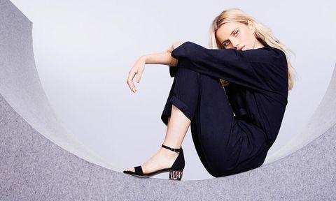 blonde woman wearing dune crystal heel sandals