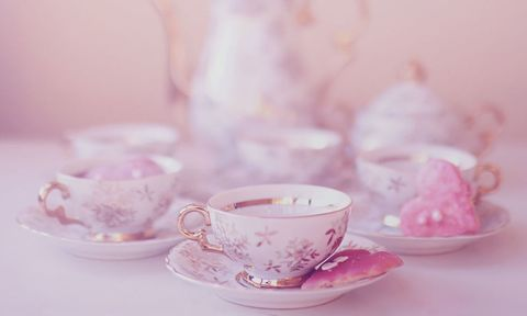 pink teapot and teacups with biscuits