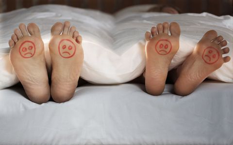 Feet sticking out of bed with sad faces