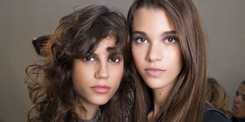 Two brunette girls with natural makeup