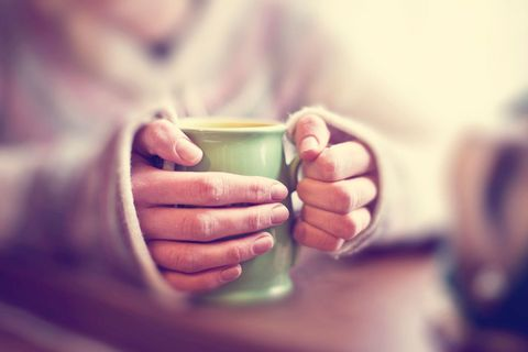 Woman holding mug of tea