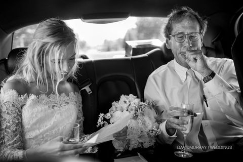 """<p>""""I always ask to be included with all parts of a bride and groom's day, including transportation to the ceremony and reception. One never knows when that special moment and connection will occur. Caroline was reading a letter written by her dad, while both were being driven to the ceremony. The letter expressed the father's love and pride for his daughter. Dad started to tear up, which made Caroline do the same. At that moment she said, 'Dad, if you continue like this I am going to ruin my makeup!' With that she started to laugh, which eventually let dad do the same. This photo illustrates two milestones on a wedding day—that of the joyous bride and her future life, while the father says goodbye to his little girl."""" --<em>David Murray, </em><a href=""""http://www.davidmurrayweddings.com/#p=-1&a=0&at=0"""" target=""""_blank""""><em>David Murray Weddings</em></a></p>"""