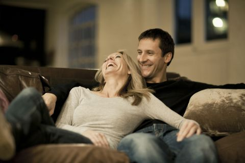 couple laughing on couch