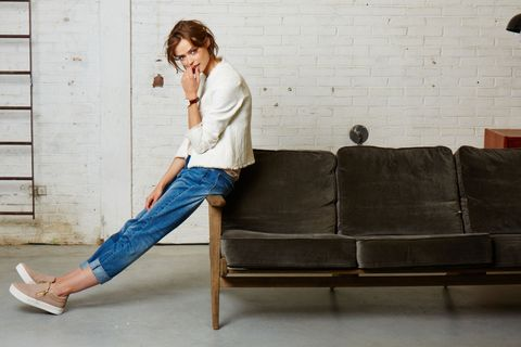 Clothing, Trousers, Denim, Jeans, Couch, Sitting, Wall, Knee, Street fashion, Comfort,