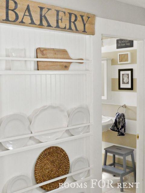 Dishware, Wall, Shelving, Interior design, Plate, Shelf, Serveware, Wood stain, Rectangle, Circle,