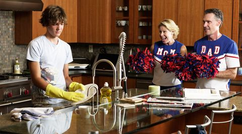 Teenager cleaning encouraged by parents