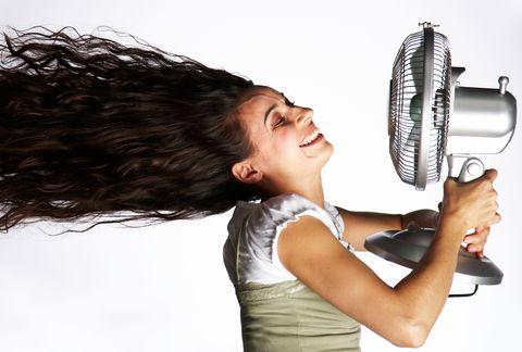 Hot woman with fan, perimenopause