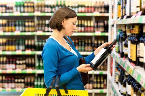 Woman choosing bottle of wine