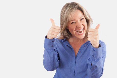 Happy woman doing thumbs-up