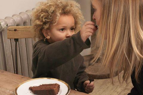 Boy feeding cake