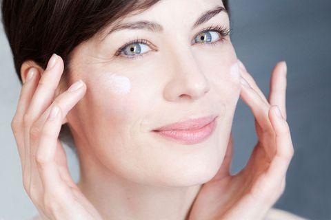 Woman using face creams/facial serums