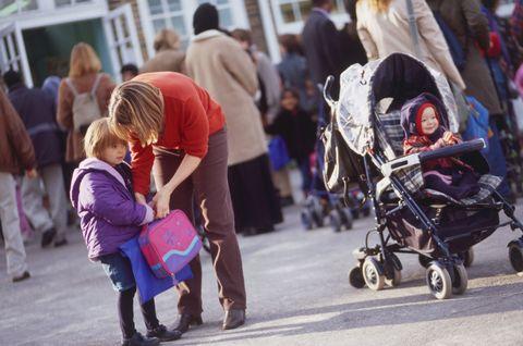 School playground, mum and child