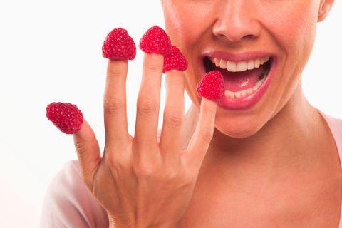 eating raspberries
