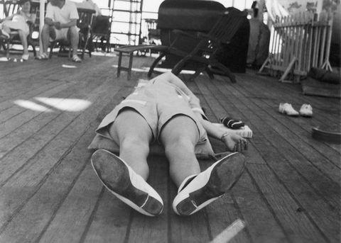 Woman asleep on floor