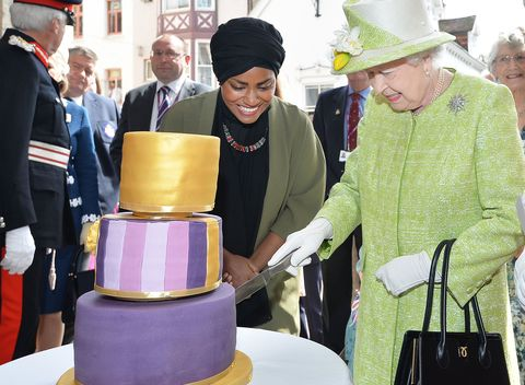 The Queen cuts her cake baked by Nadiya