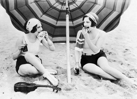 Women eating on the beach